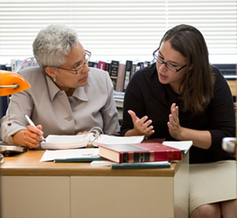 An admissions counselor helping a student