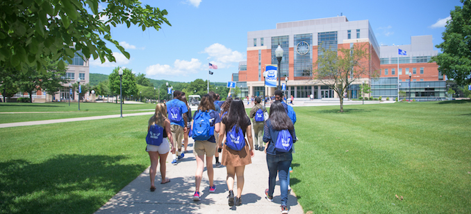 students walking toward buley library in summer